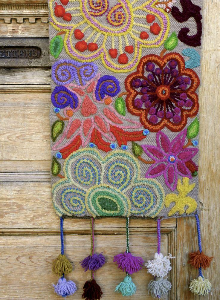 Kaleidoscope handmade wool table runner. Made by artisans in Peru. threadsofhopetextiles.org threadsofhopetextiles.org/shop