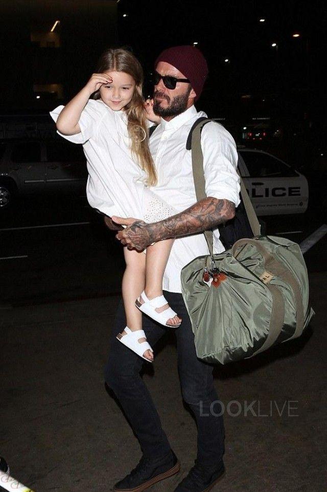 David Beckham wearing  Vans Sk8 Hi Sneakers, Ray-Ban 'Classic Wayfarer' 54mm Sunglasses, Ralph Lauren Packable Flyers Duffel, Saint Laurent Raw Edge Skinny Jeans