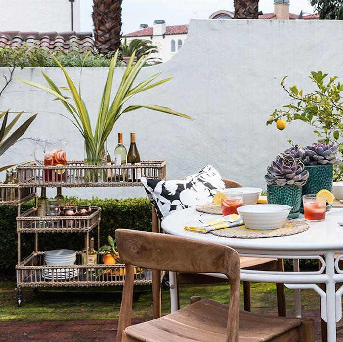 Use beautiful throw pillows and bar carts to enhance your outdoor chill spots