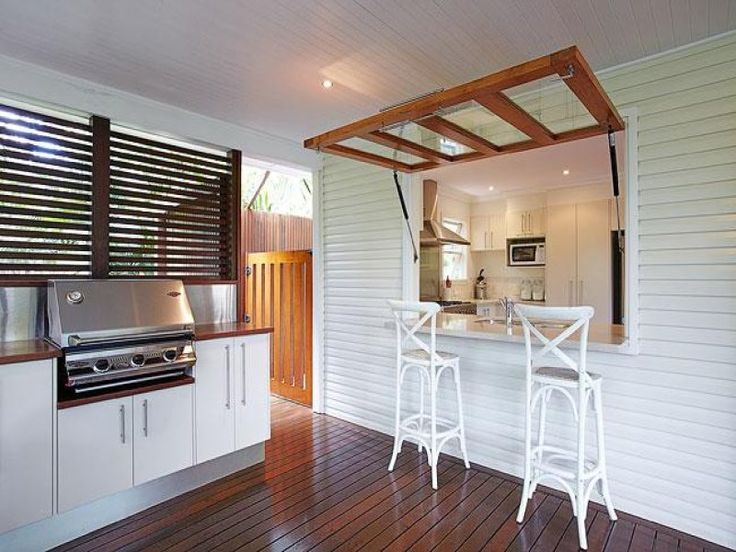 This is a very cool idea!! Entrance Door used as servery window, perfect for the deck.