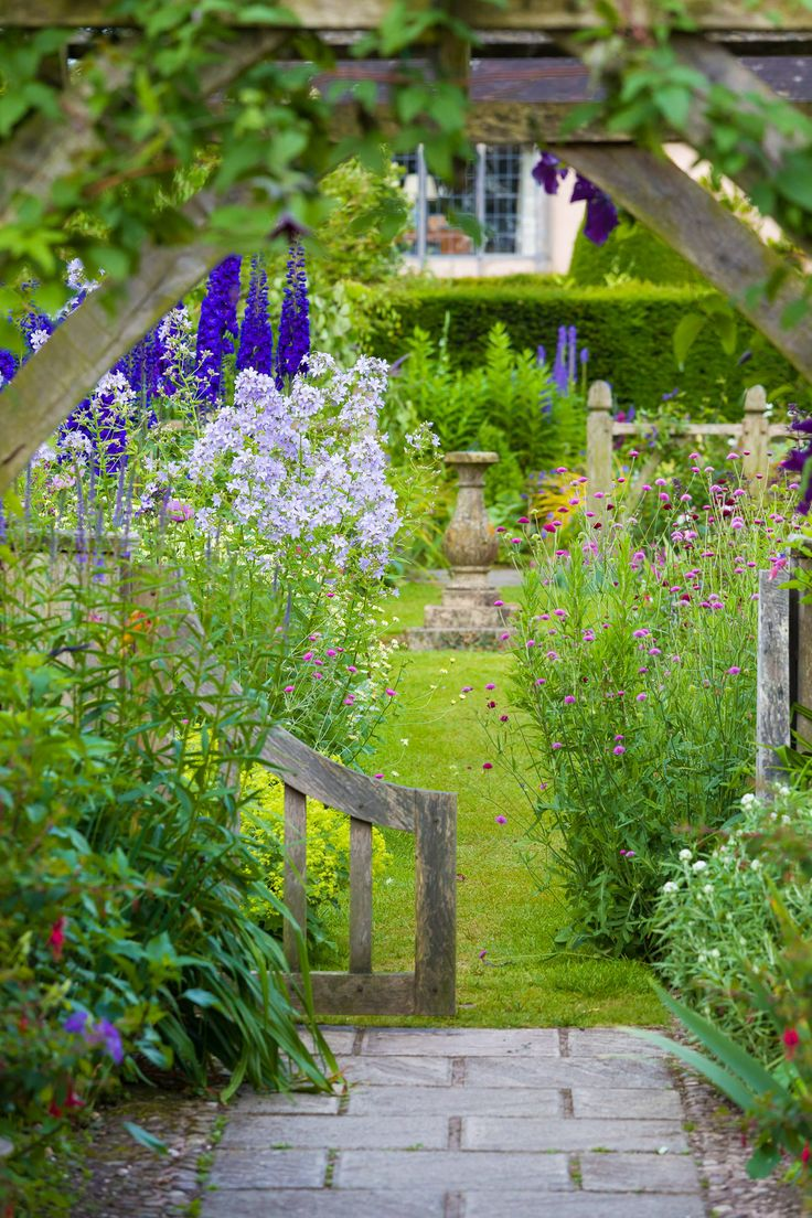 Cottage garden with bird bath or sundial - either way, it's lost its top.