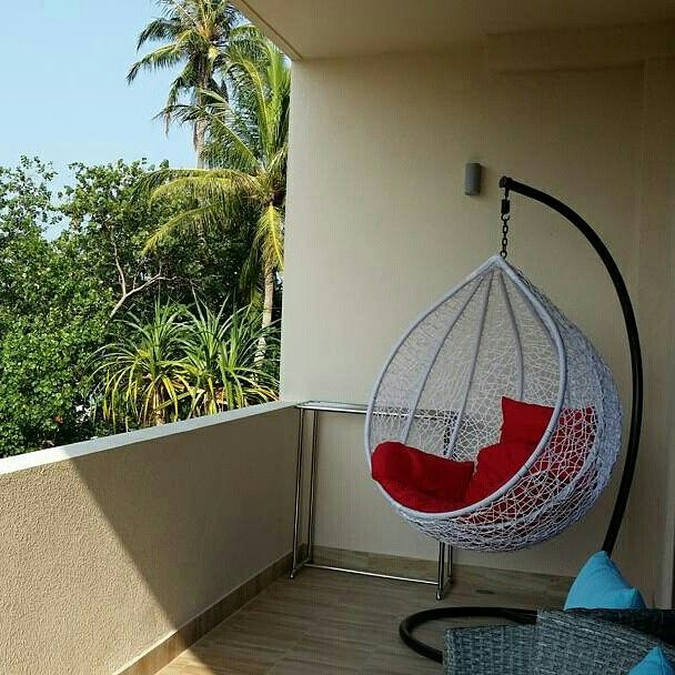 Executive Suites have spacious balconies with swing chairs  #Maldives #travel #thulusdhoo #indianocean #hotel #islandlife #vacation #getaway
