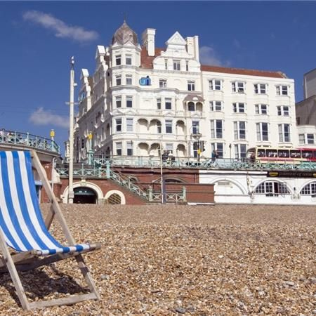 Brighton beach. Deck chairs seem quaint now but still are much in use here.
