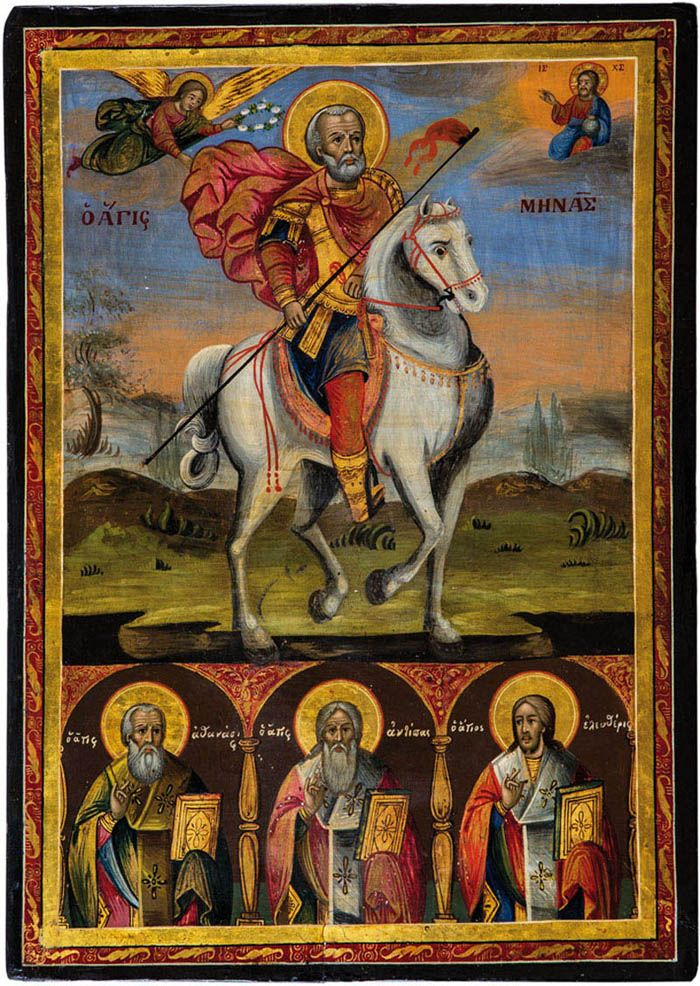 St. Menas. Greek, 19th centuy. Tempera on gesso on wood panel. Menas sitting on a white horse and holding a lance. Christ appears in the upper right corner. The lower border showing three selected saints in bishop's attire. 52 x 37 cm.
