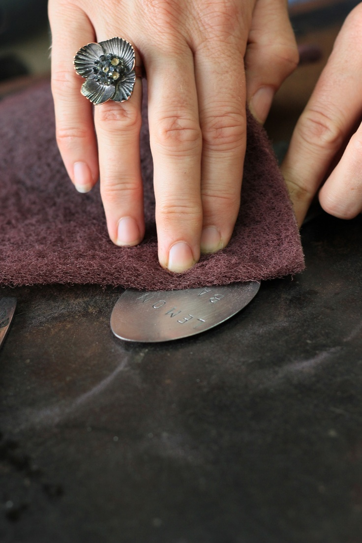Give the spoon a good rub with a wire scourer to darken the lettering. Makes it easier to read.
