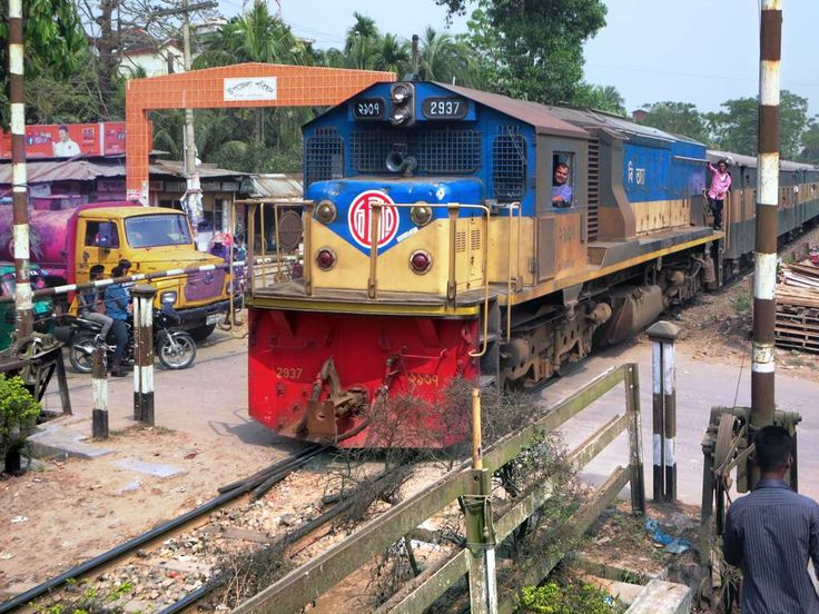 The train from Sylhet passes a level crossing near Srimongal Railway Station, Bangladesh.