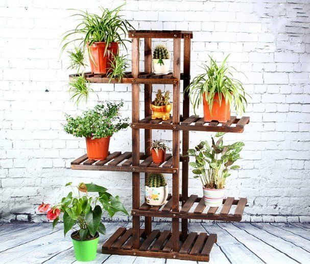 Simple wooden plastic pallets filled with flowers