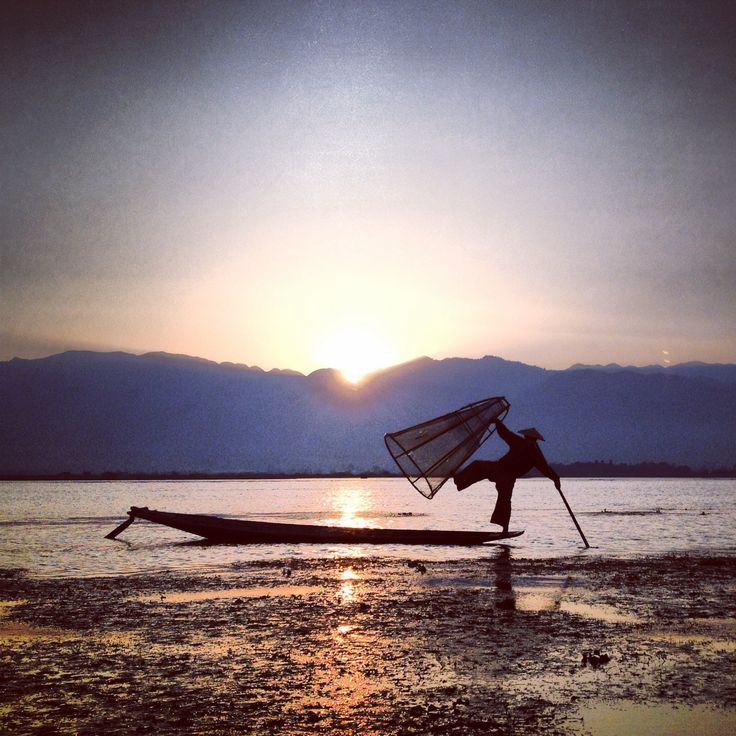 A fisherman on Inle Lake in Myanmar (Burma). I took this at sunrise. Loved this place and absolutely LOOOOVED the people...so friendly! Go visit, I highly recommend it!