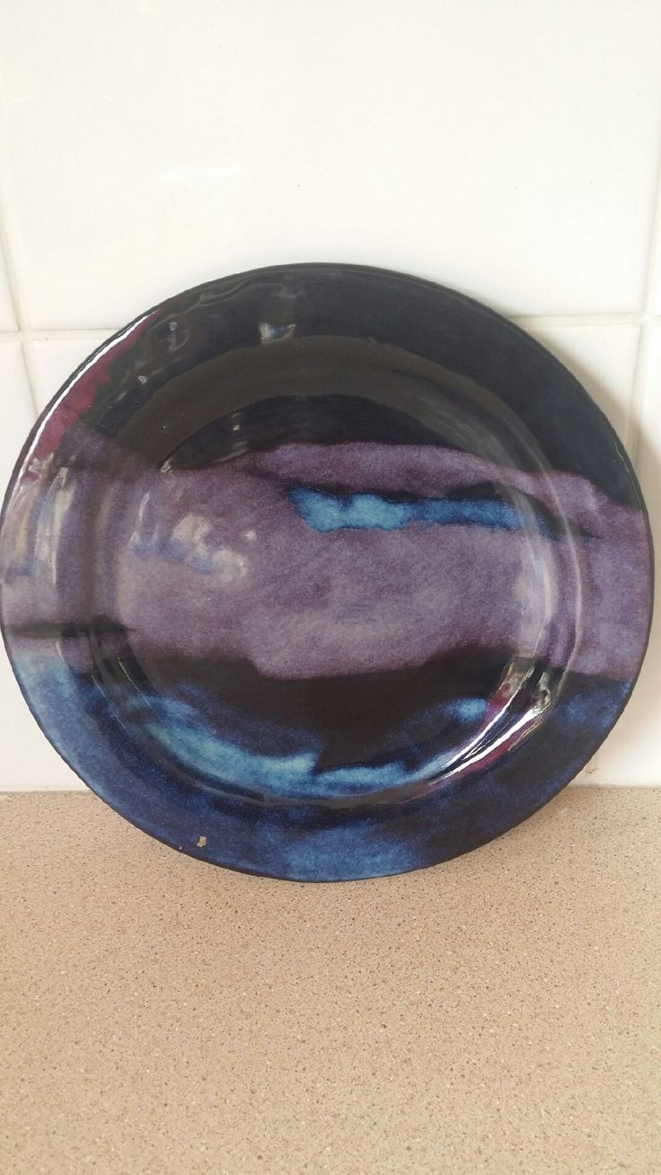 Hand built plate with multi colour glaze.