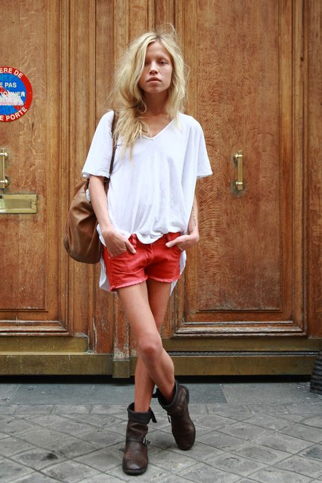Neon orange shorts, flowy top, chunky boots... such an unexpected (and yet perfect) combo.