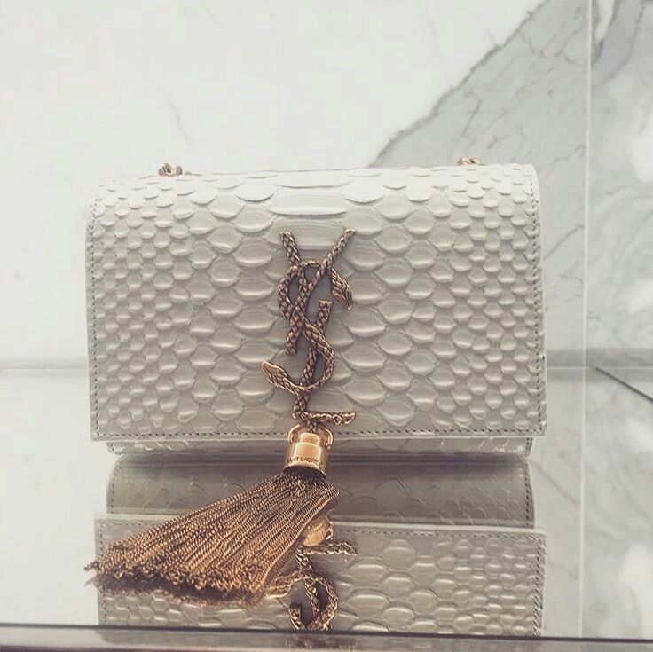 YSL tasseled clutch