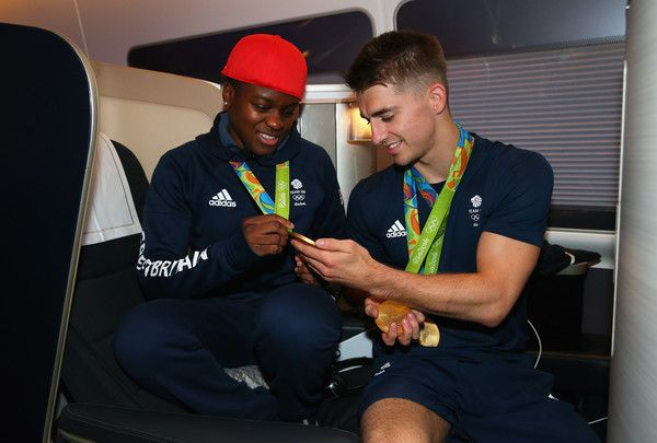 Nicola Adams and Max Whitlock of Great Britain pose with their medals during the Team GB flight back from Rio on British Airways flight BA2016 on August 22, 2016 in Rio de Janeiro, Brazil.