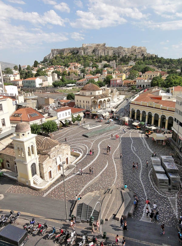 VISIT GREECE| Monastiraki square, Athens. Monastiraki (little Monastery) is an old part of Athens city, which nestles under the Acropolis. Monastiraki square is the hub of life around here and the main street leading off takes one to narrow streets with many artifacts to buy and sell!