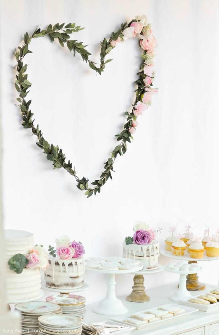 Ethereal bridal shower decor idea -  dessert display with greenery heart + assorted cakes {Courtesy of Kara's Party Ideas}