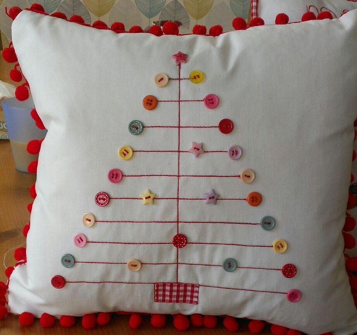 Button embellished christmas cushion