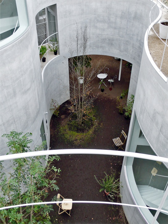 curving concrete wall + abstract landscape. love
