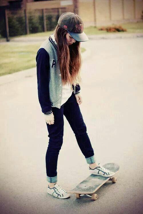 White tee + grey/black Letterman jacket + jeans + white sneakers