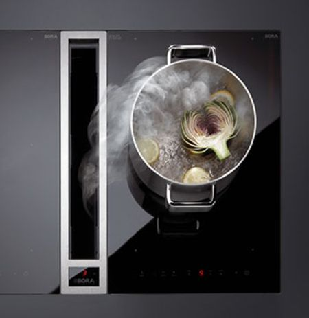 The trend for 'less is more' is very popular and hidden range hoods are increasingly used in kitchen design. (AMC)