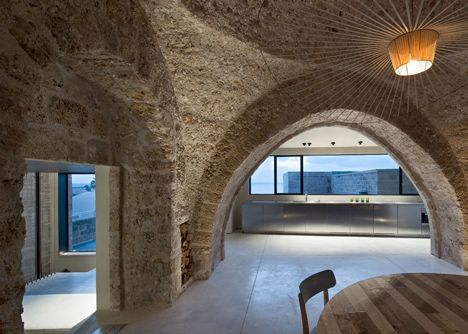 Jaffa House | Israeli architect Pitsou Kedem has exposed vaulted ceilings and stone walls inside this renovated house in the ancient port of Jaffa, Tel Aviv