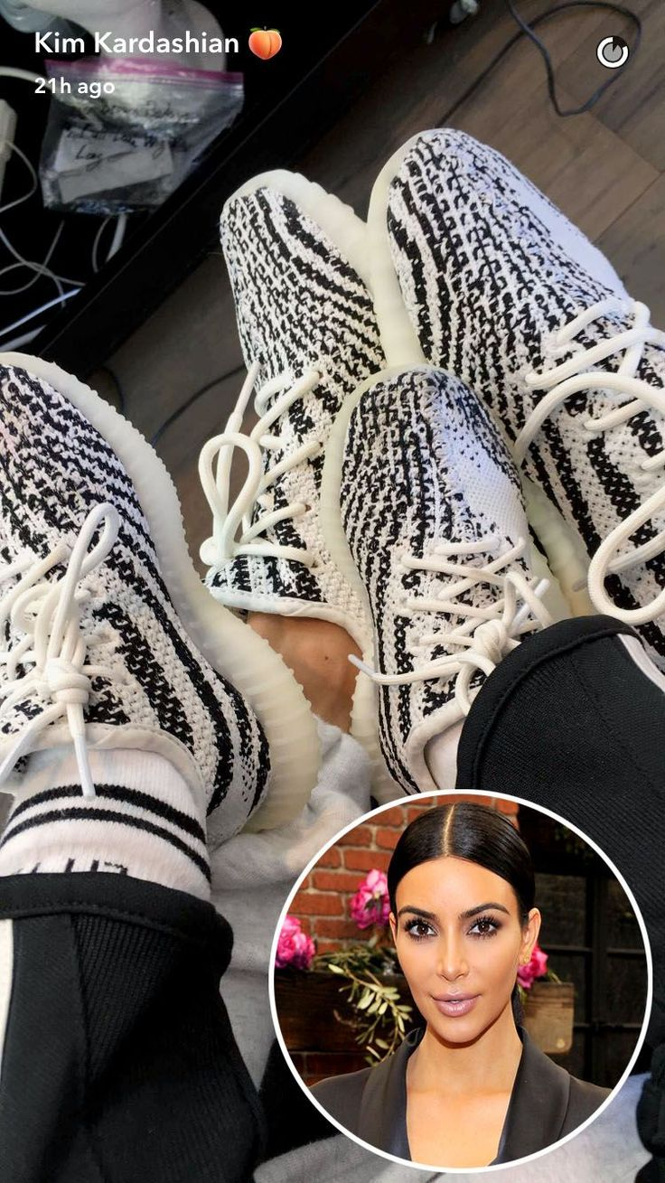 """In support of Kanye West's fashion endeavors, Kim Kardashian West and the couple's 14-month-old Saintwore matching Yeezy sneakers.  Three moresnaps show the little guy sporting the app's flower-crown filter, being mesmerized by water and saying """"Dog"""" asKardashian Westtinkers withSnapchat's puppy"""