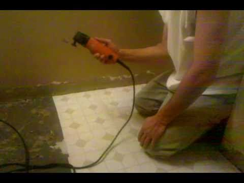 Removing Laminate Flooring wiseman tile removal A Simple Method To Remove Linoleum Flooring After Scoring The Linoleum With A Utility Knife I Used A Multi Tool To Pull The Squares Up Quick And Easy