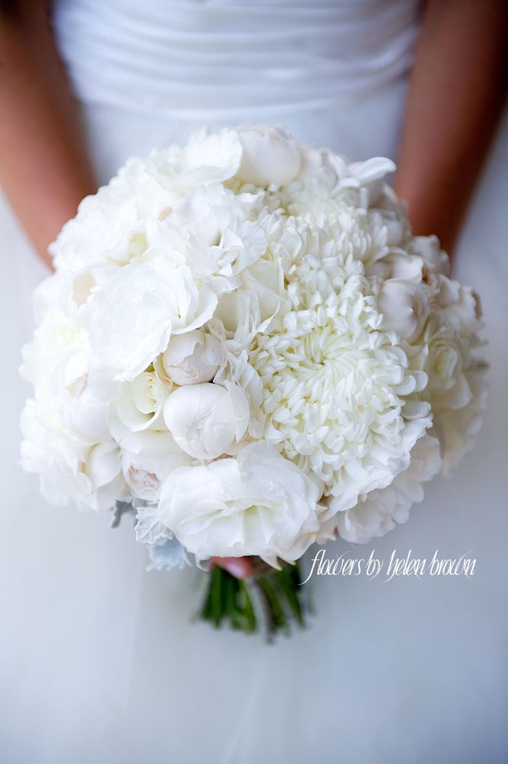 A beautiful and luscious crisp white wedding bouquet with David Austin Roses, Garden Roses, Lisianthus and Chrysanthemums designed by Flowers By Helen Brown.