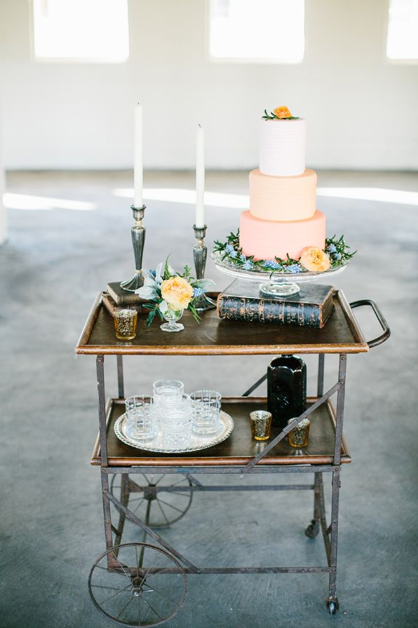 simple wedding cake display, photo by Lora Grady Photography http://ruffledblog.com/bowties-and-bourbon-southern-wedding-inspiration #caketable #desserttable #cakes