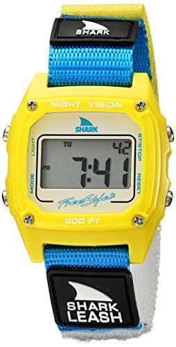 Freestyle Unisex 102242 Shark Fast Strap Retro 80's Digital Multicolored Watch with Canvas Band. Retro-inspired multicolored watch featuring logo emblems, rectangular dial window, and screw-down bezel. 38 mm resin case with mineral dial window. Japanese quartz movement with digital display. Canvas band with push-button clasp, alarms, countdown heat timer, chronograph, night vision backlight, and hydropushers that can be pressed underwater. Water resistant to 50 m (165 ft).
