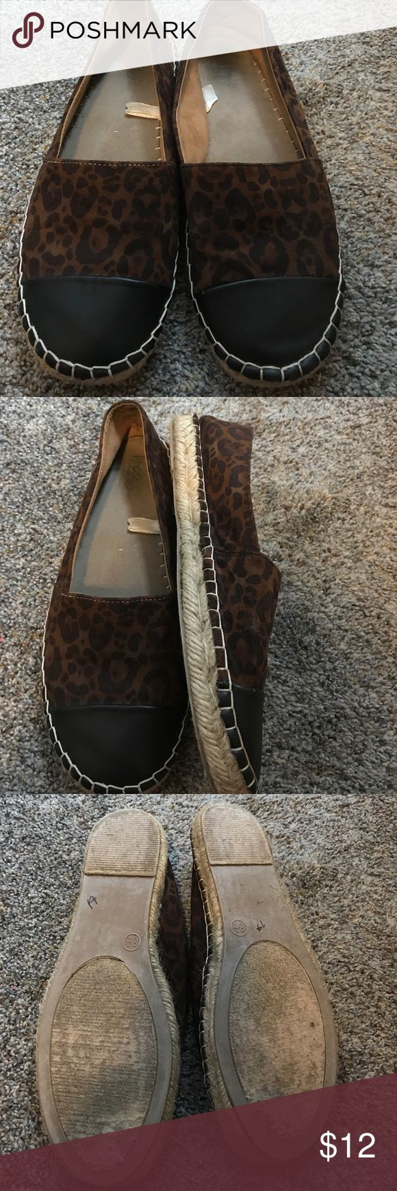 Brown animal print espadrille flats size 8.5 Mossimo animal print espadrille flats. Black faux leather toe. Preowned condition Mossimo Supply Co. Shoes Flats & Loafers