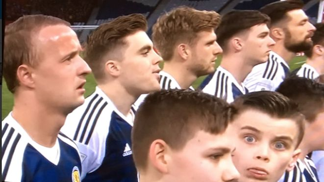 Boys will be boys. A young mascot at the Scotland v Slovenia game makes sure he's remembered during the line-up for the national anthems at the World Cup qualifier at Glasgow's Hampden Park. Scotland won 1-0 thanks to an 88th minute goal from Chris Martin. Photo via @KimDx. 27.03.17