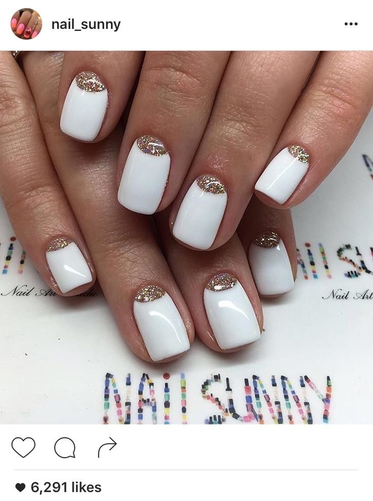 White and rose gold glitter nail art.