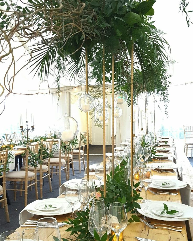 On trend Greenery themed  Wedding with gold accents & hanging globe tea lights