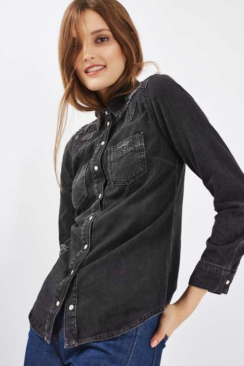 The denim shirt goes sharp with this MOTO western inspired style. Crafted from pure cotton in a vintage wash, it comes in a fitted silhouette with classic trims, a button front and handy chest pockets. #Topshop