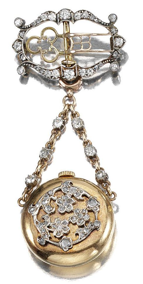 DIAMOND FOB WATCH, 1890S.  The circular dial applied with Arabic numerals, the obverse embellished with floral motifs set with rose-cut diamonds and suspended from an open work brooch accented with circular- and rose-cut stones, to two diamond-set chains of curb linking, fitted case by J. Dudley, Osborne Rd, Southsea.