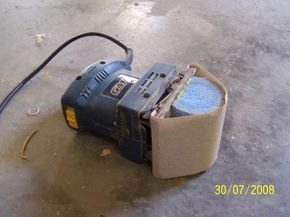 Waist Sander by jeffhigh -- Homemade guitar waist sander adapted from a sheet sander. Sanding face is retrofitted with foam to suit waist profile. http://www.homemadetools.net/homemade-waist-sander