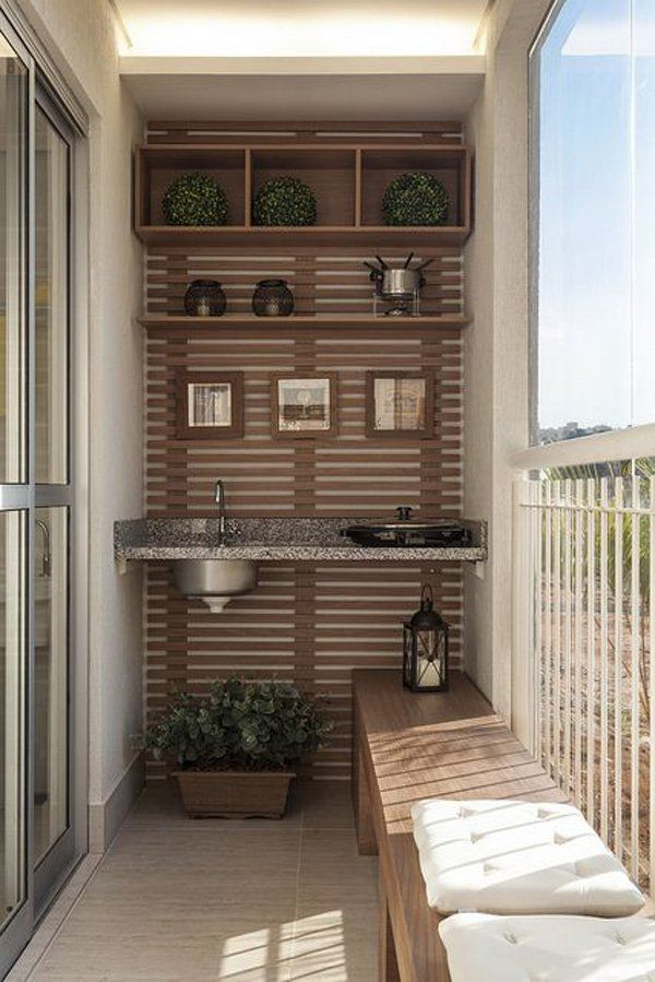 Symmetry is a great aspect to play with. Give your balcony a sheik symmetrical design with a built in shelf and adding similarly shaped furniture in each shelf. This gives your balcony an orderly and neat look.