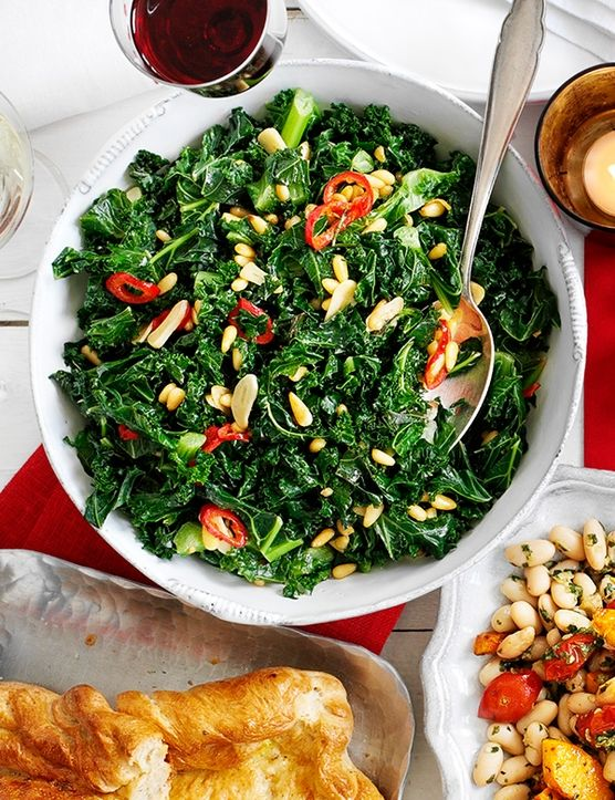 An easy way to feed a crowd, this punchy dish of winter greens with pine nuts, chilli and garlic is ready in just 20 minutes.