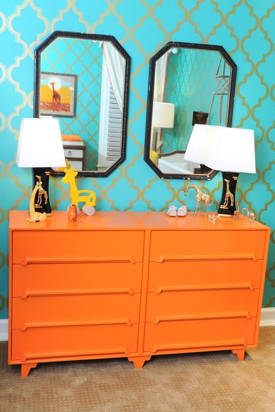 aqua and orange room decor - really like how striking it looks. Will look good with the grey couches.