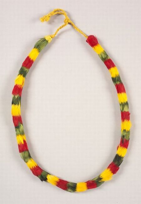 Hawaiian Feather Lei |  c. last half 19th century | With braided cloth ties, with a red, yellow, and green banded pattern | 4,700$ ~ Sold
