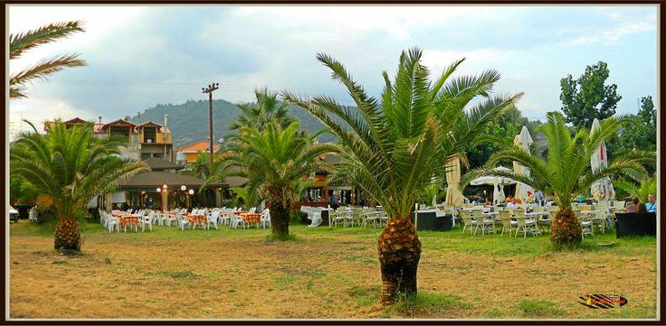 Seaside tavernas, Sarti, Halkidiki, Greece, Nikon Coolpix L310, panorama mode: segment 2, HDR-Art photography 2014.