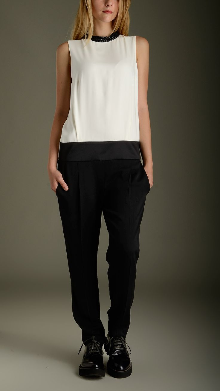 Bicoloured silk jumpsuit characterized by: a plain white top featuring contrast Swarovski detailing round neck, a wide back key-hole detail, satin silk waistband embellished black pants featuring two slant pockets at front, two welt pockets at back, regular fit, 100% silk.