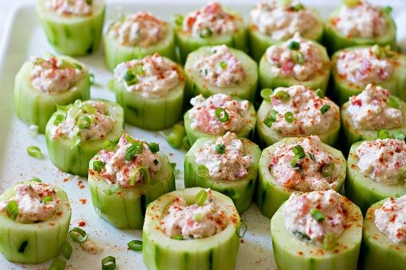 Stuffed fresh cucumbers - perfect appetizers or party mini-snacks. This one has spicy crab filling, but any filling will do - for example plain cream cheese or salmon cream cheese sprinkled with some chilli pepper or chives. Tip: use small tea spoon to dig up the middle of cucumber slice to create space for stuffing. Save the cucumber meat you have dug up and use in a salad.