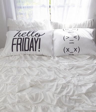 "Give a warm welcome to the upcoming weekend when you wake up with our Hello Friday Pillow Case Set! Both are crafted of comfy, lightweight material for sweet dreams; one is printed with bold ""hello Friday!"" text, while the other features playful emoticons to represent Saturday, Sunday and that dreaded Monday.<br><br>Includes two pillow cases.<br>H 19.5"" x W 31""<br>Style: 1105. Imported.<br><br>100% polyester.<br>Machine wash/dry."