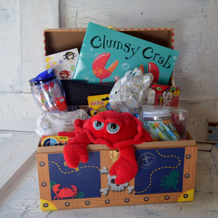 "Large ""Clumsy Crab"" Treasure Chest Gift Basket / Box Treasure Style Gift Box with Roped sides contains the following items: - Clumsy Crab Childrens Book - Day at the Beach Stickers (2 sheets) - Monste"