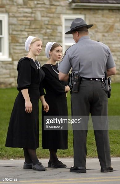 News Photo : A Pennsylvania State Police officer speaks with...
