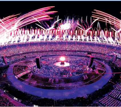 114a The editor chose to show the overall organization of the stadium using a wideshot. This  panorama  highlights the success of the opening ceremony. The image is also highly contrasted to bolden the lighting and fireworks.