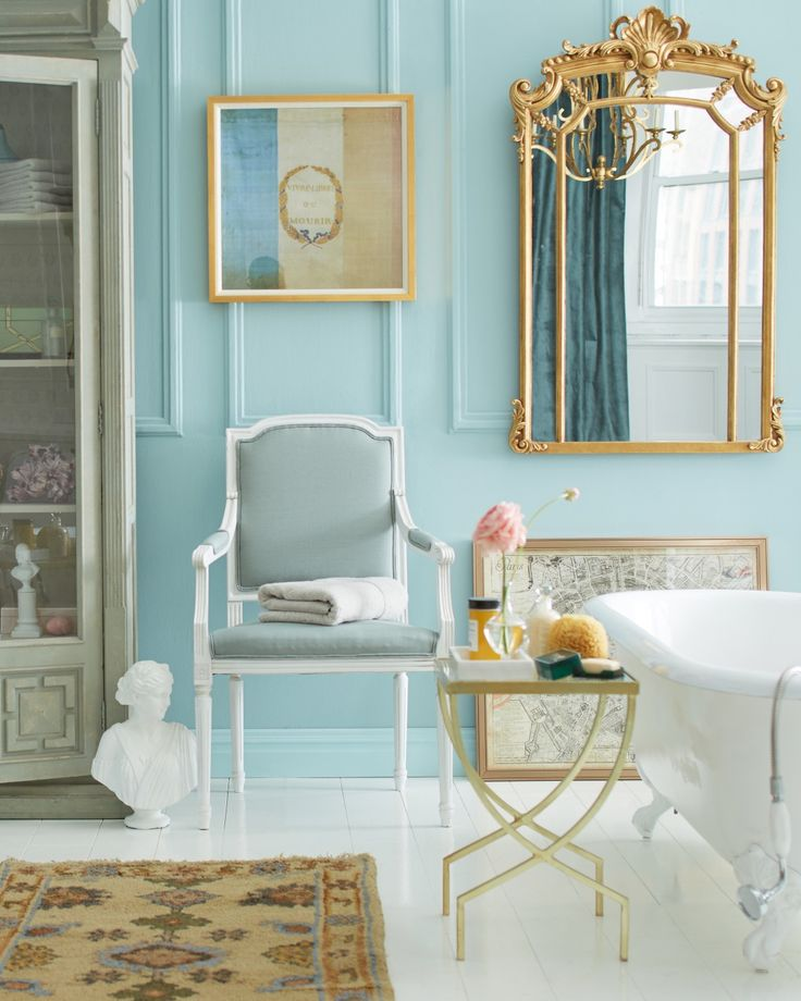 Stunning Parisian Inspired Bathroom With Light Blue Walls, Bright White  Clawfoot Bathtub And Plenty