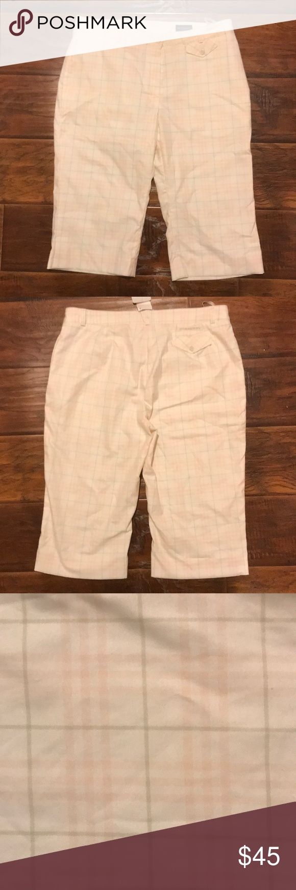 Plaid Burberry Golf Shorts Burberry Golf Shorts. Size UK 12/US 10 but seem more like a 8. I'm 5-9' and falls way past knees in length. . Pink, white and gray plaid. Never worn. Perfect Condition. Burberry Shorts Bermudas