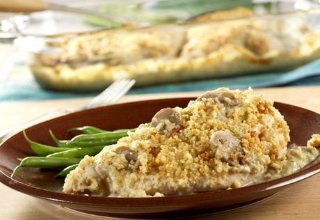 Chicken breasts are coated with a mixture of bread crumbs and  Parmesan cheese, then topped with a creamy garlic-mushroom sauce featuring Campbell's® Condensed Cream of Broccoli Soup.