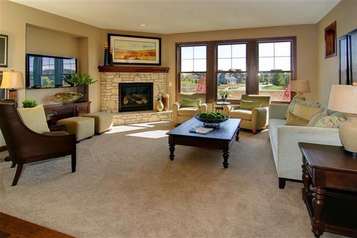 Perpendicular windows corner fireplace living room for Window placement in living room